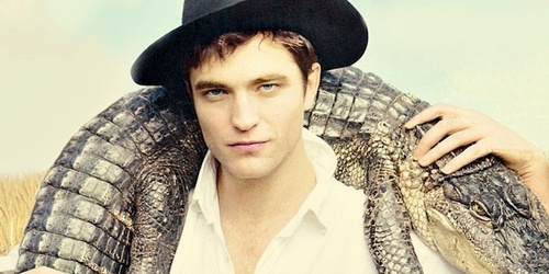 here's my handsome Robert with an alligator touching his shoulders.Later alligator...after a while,crocodile(haha)<3