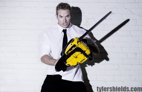 Kellan Lutz and a chainsaw