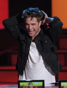 my gorgeous baby at the 2010 MTV Movie Awards with his mouth open because he's laughing at something his sweetheart,Kristen just said<3