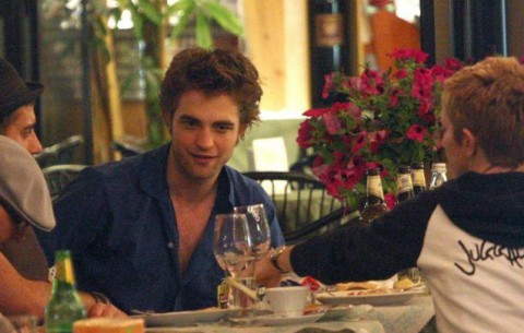 here is my handsome baby sitting at a table, tableau in a restaurant in Italy,where he was filming some scenes for New Moon<3