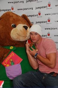 Twilight hottie Kellan Lutz with a big teddy bear.I want to cuddle both of them<3