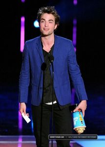 my handsome baby holding the MTV Movie Award he just won down<3