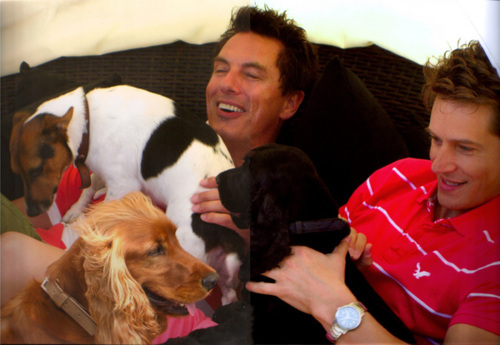 John Barrowman with his partner Scott Gill and his dogs :D
