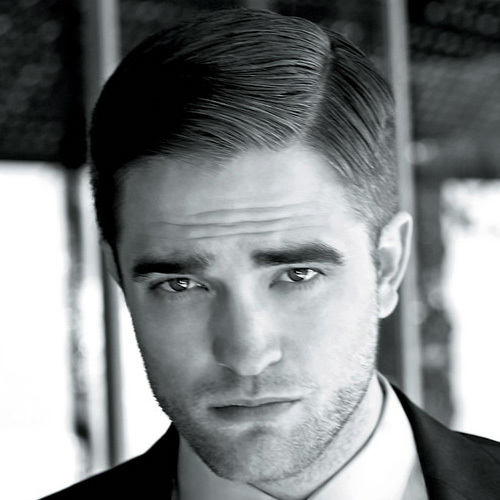 my handsome Robert with his hair parted to the side<3