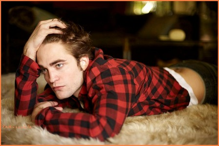 my sexylicious Robert lying on a soft white rug<3