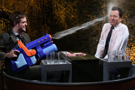 my handsome baby with a water soaker as he soaks Jimmy Fallon<3