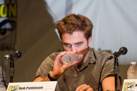 my sexy Robert at the 2012 Comic-Con with a bottle of water in his hand as he takes a sip<3