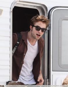 my handsome Robert wearing a brown shirt<3