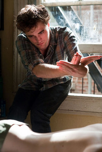 my gorgeous Robert in a scene from Remember Me with a window behind him<3