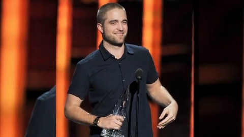 my sexy baby holding an award with one hand<3