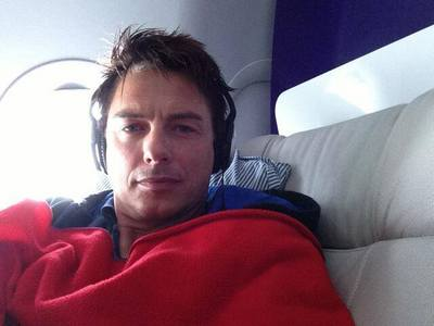 John Barrowman with a small window behind him♥