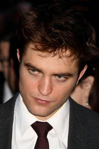 my handsome Robert leaning his face to the side<3