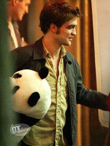 here is my gorgeous Robert with a stuffed panda(does that count?)<3