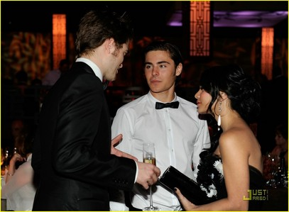 my gorgeous Robert at an awards after party talking with Zac Efron and Vanessa Hudgens<3
