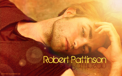 my insanely sexy Robert being kissed kwa the sun.I want to be the one kissing my gorgeous Robert<3