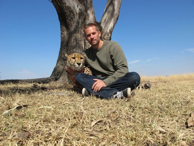 my handsome American hottie,Paul Walker with a cheetah,who has spots(and happens to be one of my fave animals)<3