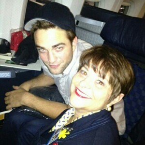 my gorgeous Robert on a plane,posing for a pic with one of the flight attendants <3