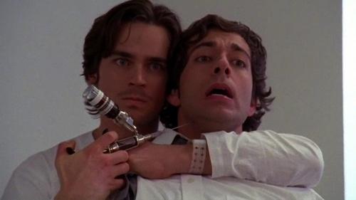Matt Bomer standing behind Zachary Levi (a scene from Chuck vs The Nemesis)