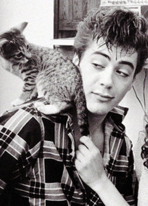 very young D with cat