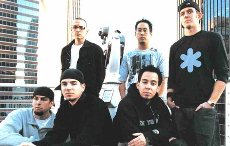 Chester Bennington is the singer Mike shinoda is the rapper  Brad delson is the guitarist  Dave Farrell is the bassist  Joe Hahn is the dj  Rob bourdon is the drummer
