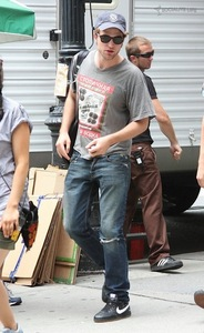 my handsome Robert wearing light blue jeans with a rip in the knee<3