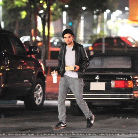 my handsome British babe walking the streets,with cars behind him<3