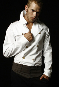 Twilight hottie Kellan Lutz wearing a white jacket<3