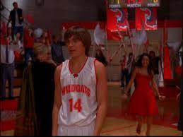 Zac Efron in one of the last ending scenes (just after he won his বাস্কেটবল game) in the 1st High School Musical movie (: