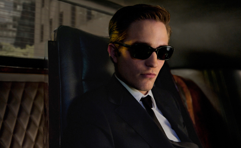 my very sexy Robert wearing sunglasses.He's so cool,he's gotta wear those shades...even inside a limo<3<3<3