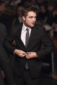 my handsome Robert buttoning his jacket<3<3<3