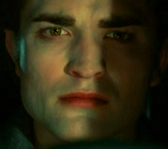 my gorgeous Robert,in a scene from Twilight with part of his face in light and part of it shaded<3