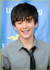 Greyson Chance. Our birthdays are on August 16th. We were even born in the same year, 1997. I wish I could be Friends with him and call him my 'twin brother'. X3