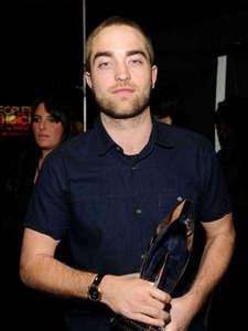 my handsome Robert wearing a watch<3