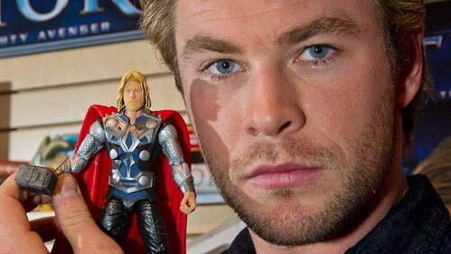 Chris Hemsworth with his Thor toy action figure<3
