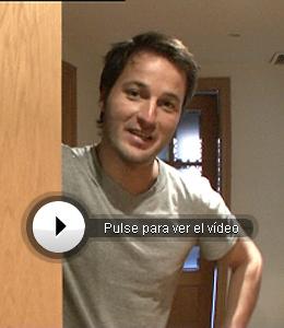 Fernando opening the door of his house.