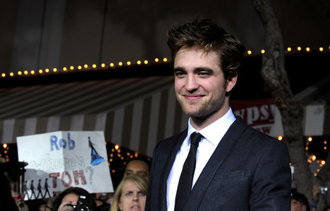my gorgeous baby at the New Moon premiere with lights behind him<3