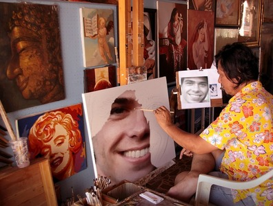A woman painting Matthew Lawrence. <3333