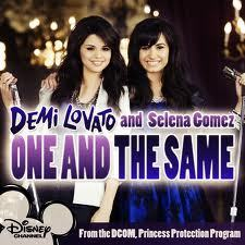 ONE AND THE SAME cuz she sings that with her best friend Demi Lovato and SLOW DOWN cuz itis awesome!!!!! DDDAAA......