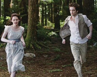 my handsome baby and the beautiful Kristen Stewart in a scene from New Moon with luar angkasa between them<3