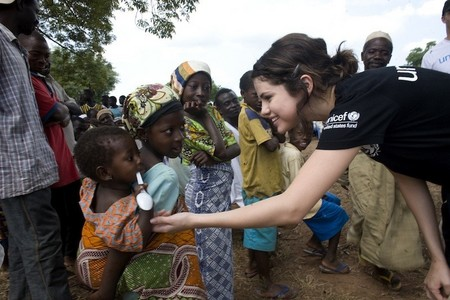 Post a photo of Selena helping poor people. - Selena Gomez ...