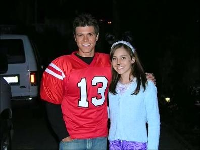 Matthew wearing a red football shirt. :)