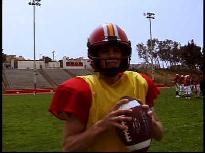 Matthew on the set of The Hot Chick at a football field practicing.