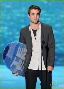 my baby holding a Teen Choice award surfboard he had just won<3