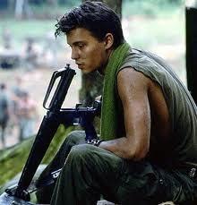 Johnny Depp holding a gun..
