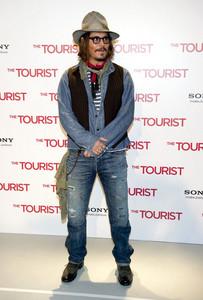 Johnny Depp wearing jeans .