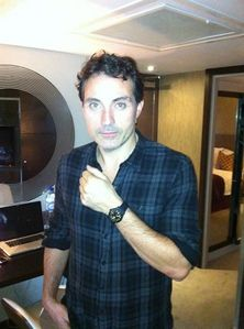 Beautifully modelling his watch. =D
