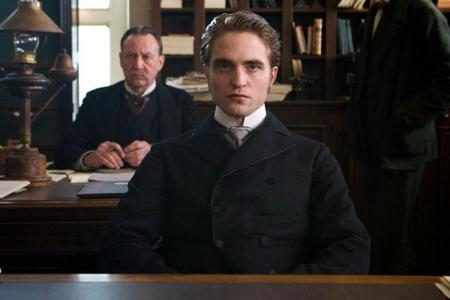 my sexy Robert,in a scene from Bel Ami sitting at a table<3
