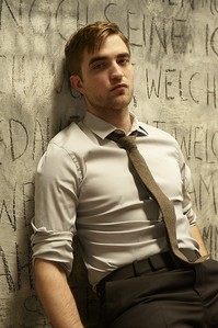 my sexy Robert leaning against a wall<3