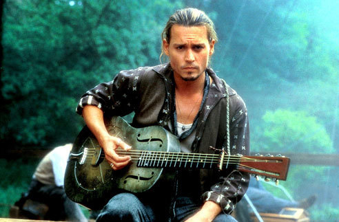 Johnny Depp with a green background ..