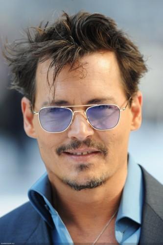 Johnny Depp wearing a blue suit <3